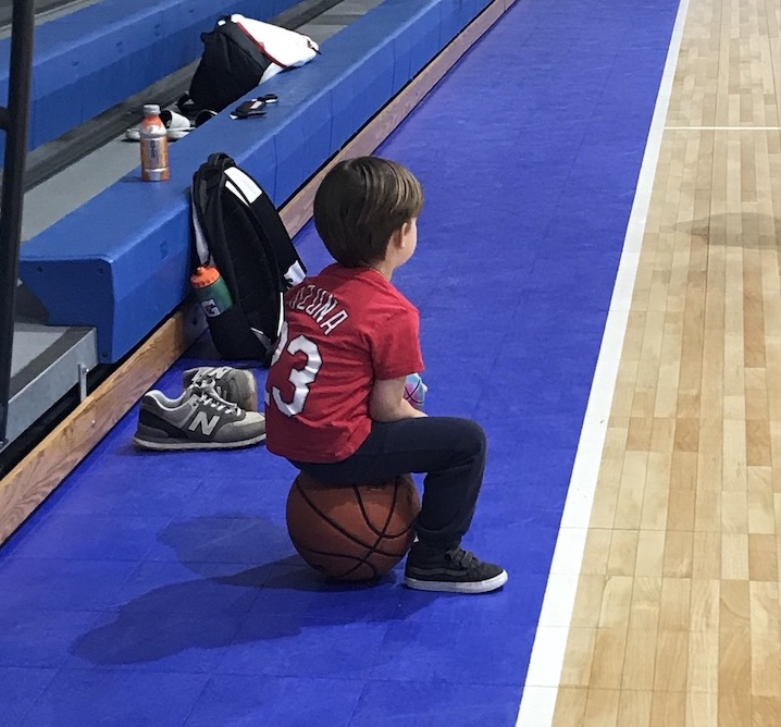 Low Country Storm_child sitting on a Basketball